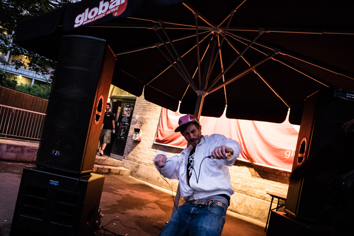 Åsmund DJing on his iphone outside Club Global